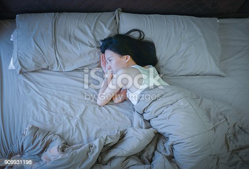 istock Asian woman suffering from Depression on bed 909931198