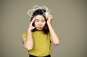 istock Asian woman suffering from dizziness having side effect from birth control pills 1282835761