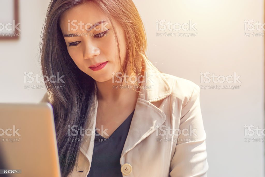 Asian woman suffering from mental illness. business woman in depression fear, sad and unhappy from work environment at office workplace royalty-free stock photo