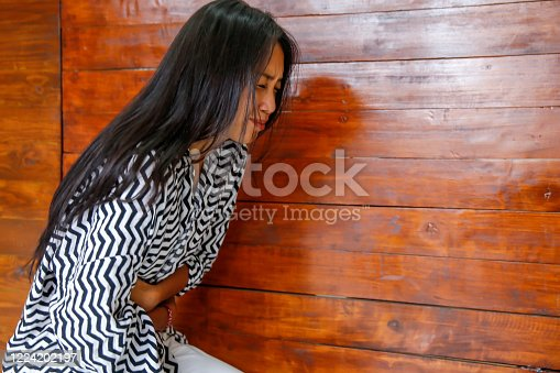 istock Asian woman suffering PMS stomachache 1224202197