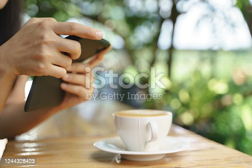 istock Asian woman take a photo of hot latte coffee 1244328423