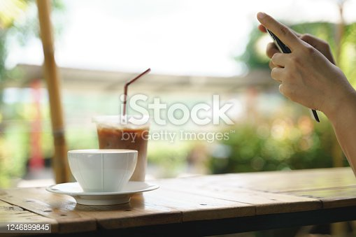 istock Asian woman take a photo of hot latte coffee 1246899845