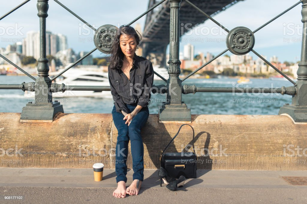 Asian woman taking a break and being barefoot стоковое фото