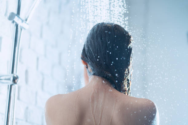 Asian woman taking a shower the back of her picture stock photo