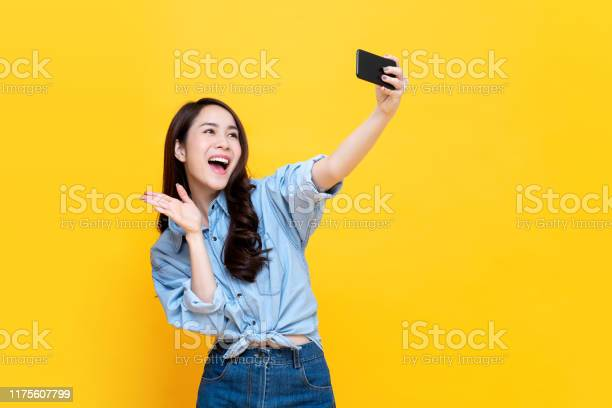 Asian woman taking selfie isolaed on yellow background picture id1175607799?b=1&k=6&m=1175607799&s=612x612&h=bx5c zmffj8axig9jfg6d4aix3e e0wnlbmewwf5iny=