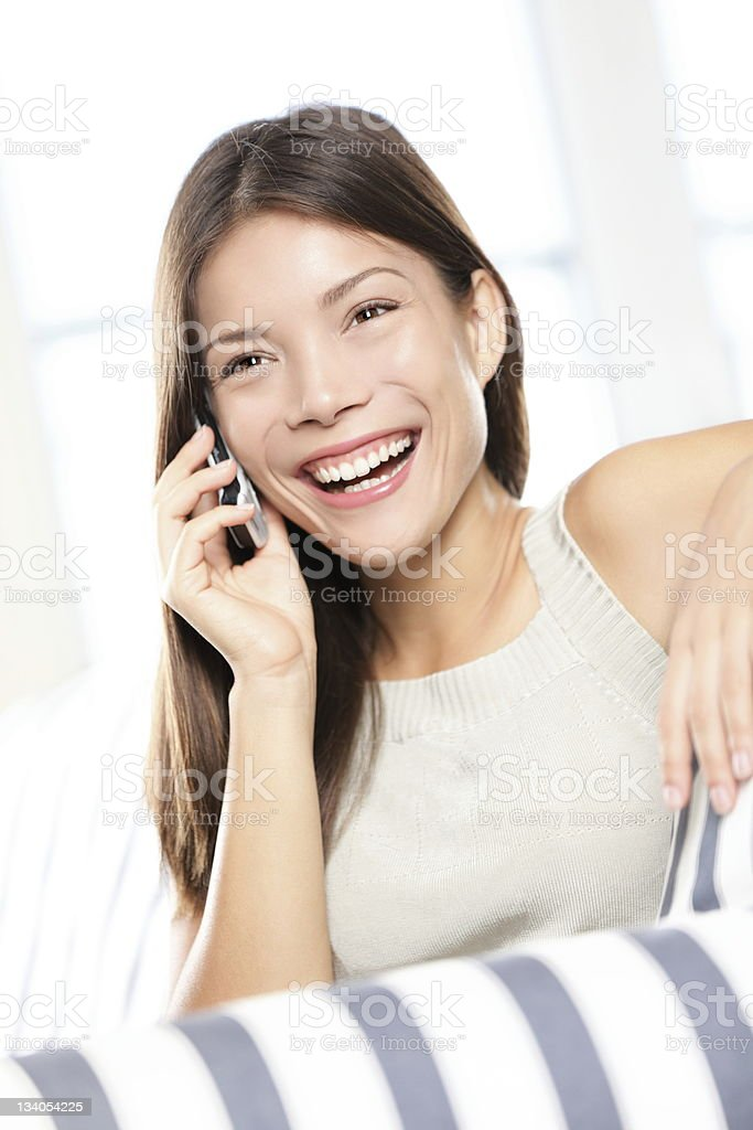Asian woman talking on smart phone royalty-free stock photo