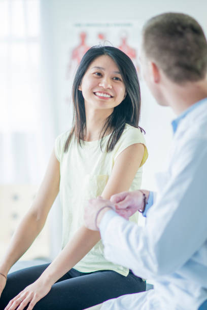 Asian Woman Talking to Doctor stock photo