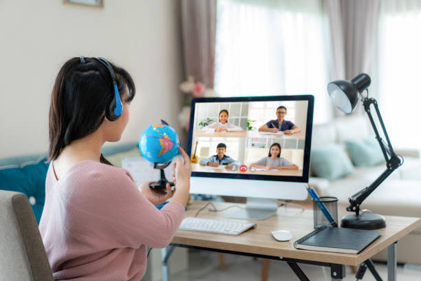 asian woman teacher teaching geography via video conference e-learning and cheerful elementary school student looking at globe, homeschooling and distance learning ,online ,education and internet. - teacher school solo imagens e fotografias de stock