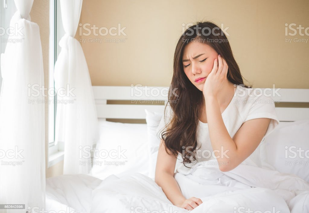 Asian woman toothache, pain, hurt and injured, tooth, teeth and dentistry woman concept stock photo