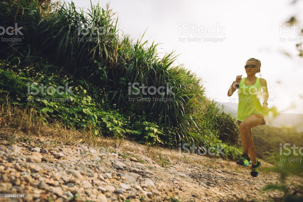 new style a9863 fa328 Asian Woman Trail Running On Mountain - Fotografie stock e ...