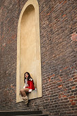 asian woman traveler  sitting on urban wall