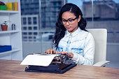 Asian woman typewriting