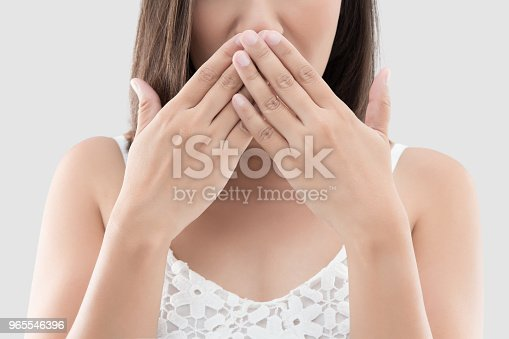 istock Asian woman use both hands close mouth for not commenting or refusing on gray background 965546396