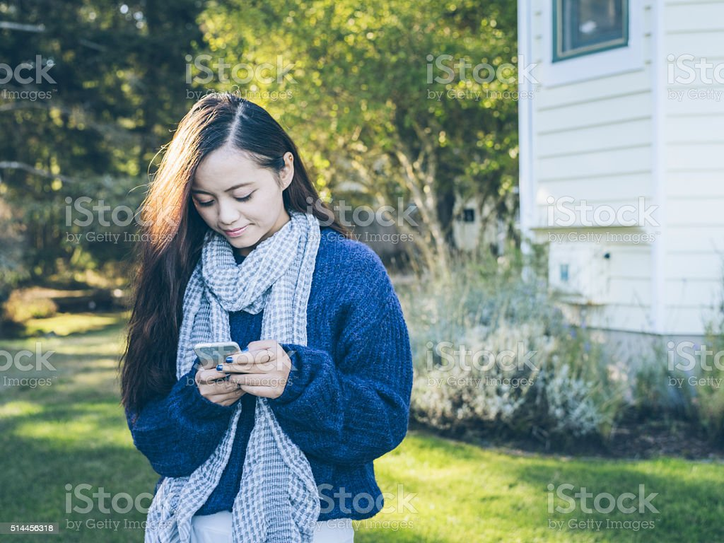 asian woman using cellphone stock photo