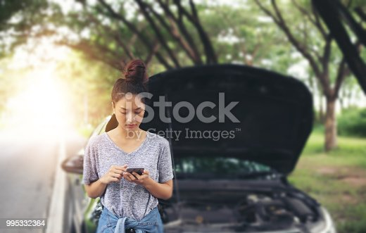 Asian woman using mobile phone while looking and Stressed man sitting after a car breakdown on street