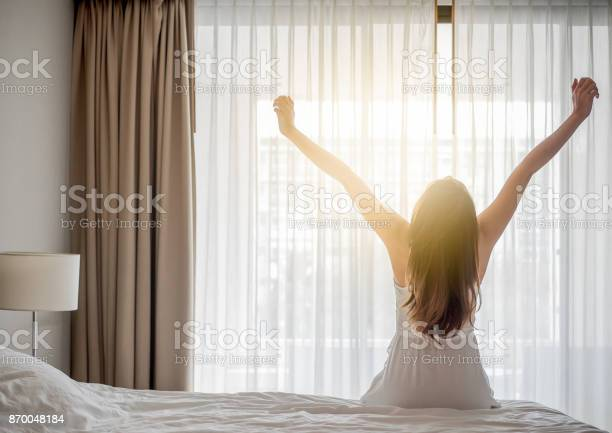 Asian woman wake up in the morning sitting on white bed and feeling picture id870048184?b=1&k=6&m=870048184&s=612x612&h= gvhkdnqsl n boerahifahbrzn6di5bcnd3ziokehs=