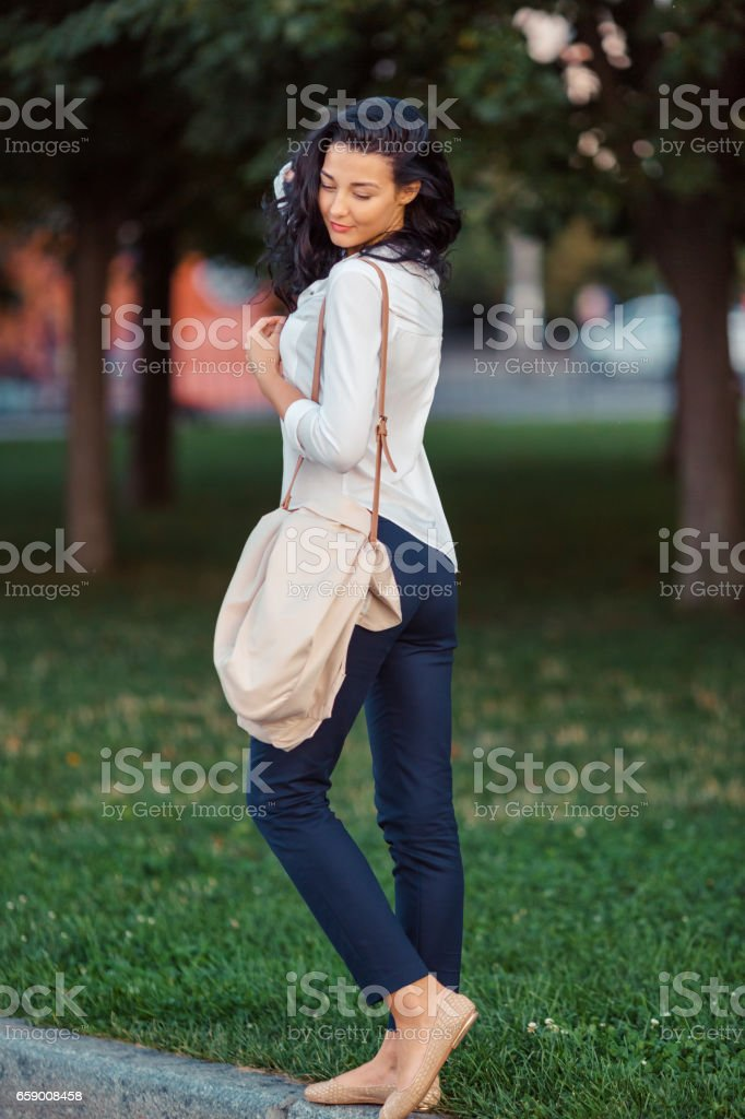 Asian woman walking in park royalty-free stock photo