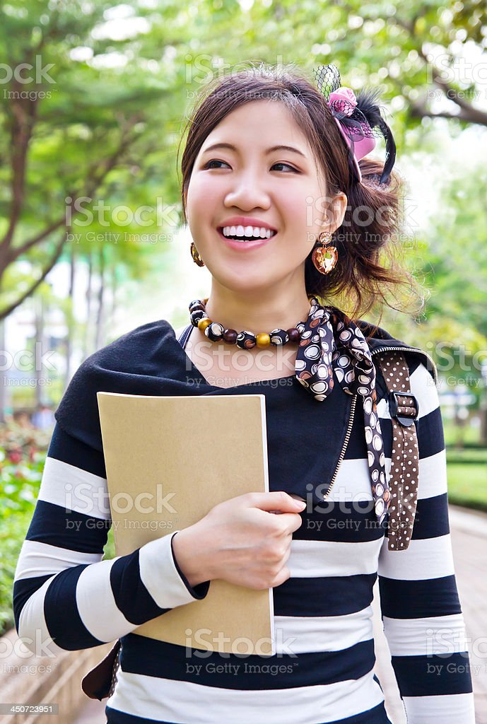 Asian woman walking in the park stock photo