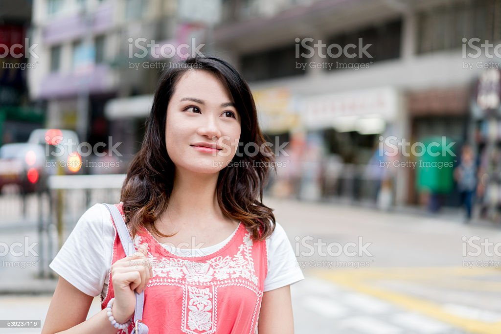 Asian woman walking on the street royalty-free stock photo