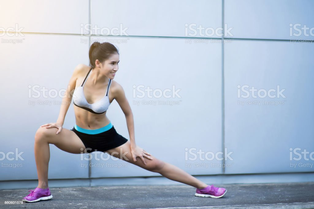 Asian woman warm up before exercise stock photo