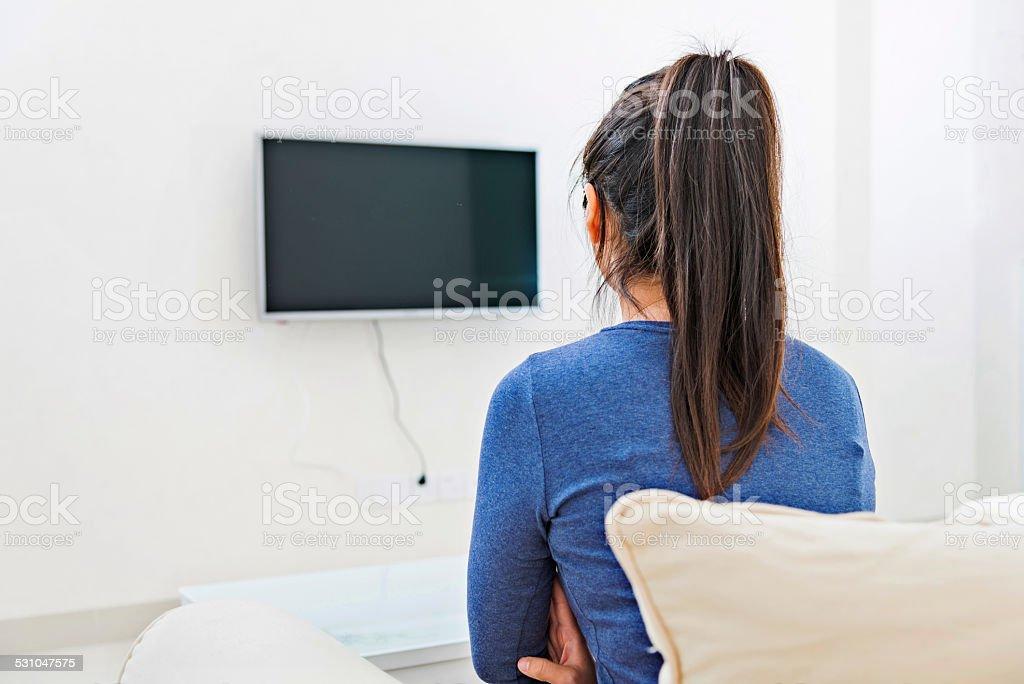 asian woman watching TV stock photo