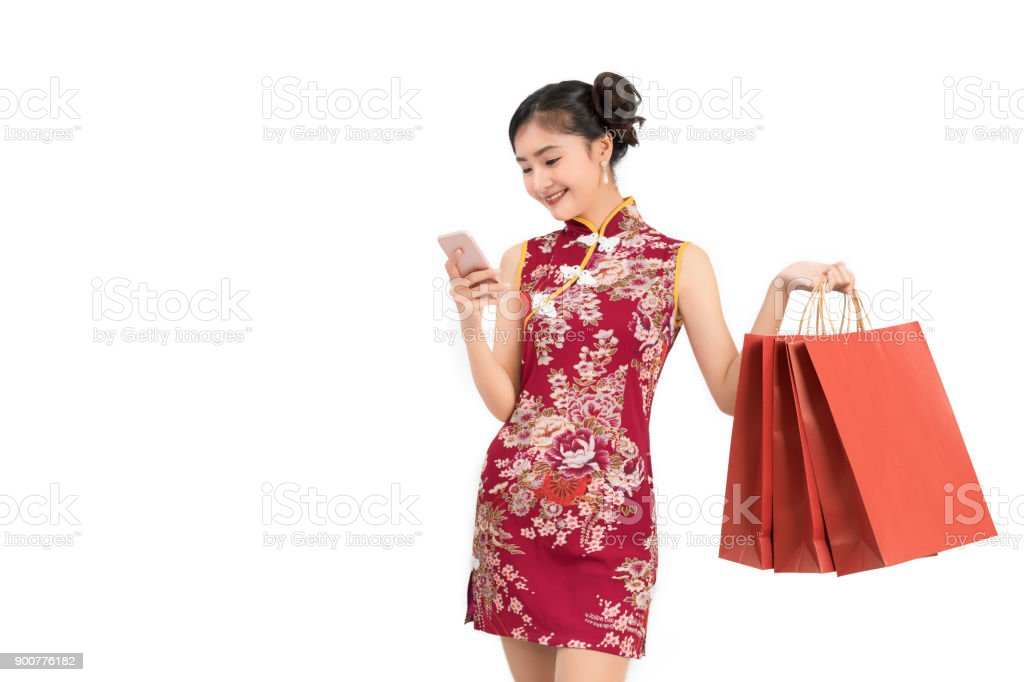 asian woman wearing chinese dress with mobile smartphone shopping