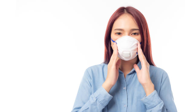 Asian woman wearing face mask for prevent pm2.5 anti pollution, viruses or coronavirus, covid 19. Beautiful girl get fear from corona virus, air pollution and pm 2.5 environmental, health care concept stock photo