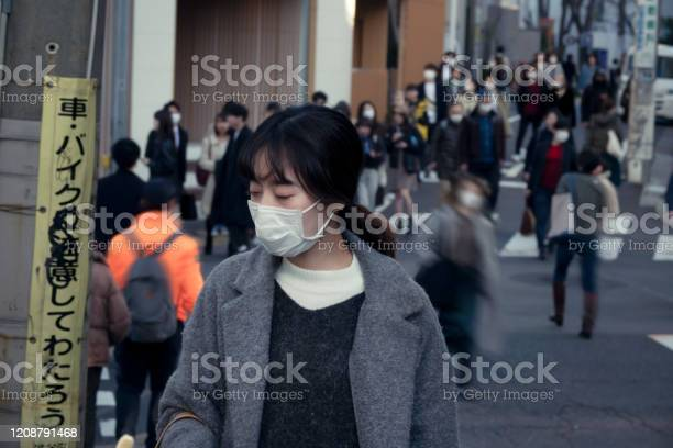 Asian woman wearing face mask on the street at rush hour picture id1208791468?b=1&k=6&m=1208791468&s=612x612&h=y1ltfipifadfrnwy dtnokriibukuyghkcewi559 ie=