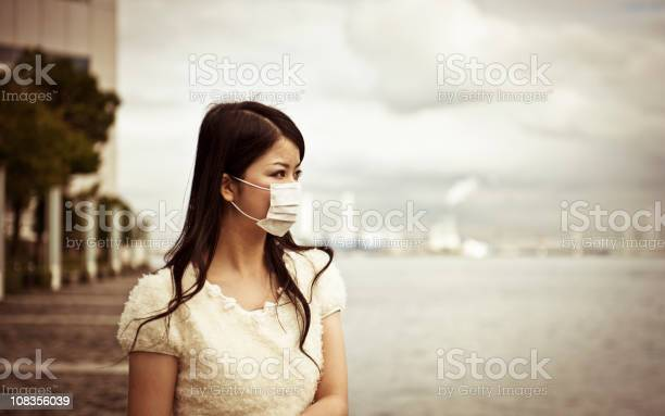 Asian woman wearing face mask with a blurred background picture id108356039?b=1&k=6&m=108356039&s=612x612&h=l2mrgikzkp1jnwinbas4meve7ssf62rm8oi3iwal 4s=
