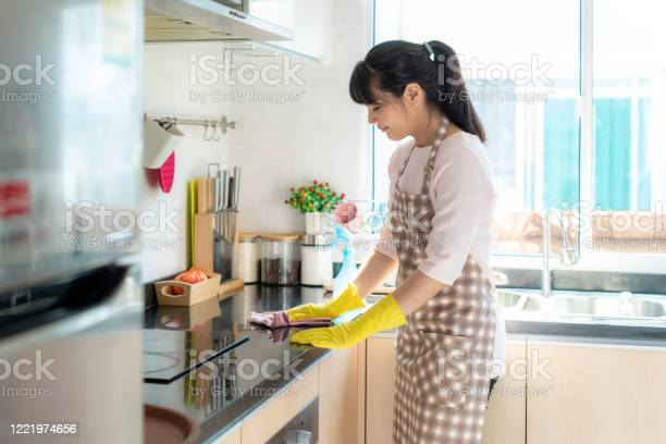 Asian woman wearing rubber protective gloves cleaning kitchen in her picture id1221974656?b=1&k=6&m=1221974656&s=612x612&h=zouaq86kaz08zyl3ltkzxwgwchnu eg05y8eh4lvyyg=