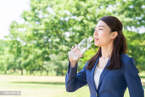 young attractive asian woman who drinks water