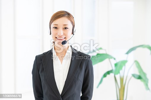 1167562098 istock photo asian woman who works as an operator 1206556376