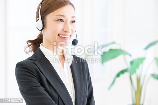 1167562098 istock photo asian woman who works as an operator 1206990073