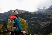 Asian woman enjoying hiking and walking in the forest  in Swiss Alps
