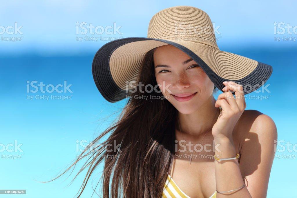Asian woman wearing fashion straw beach hat for skin care sun...