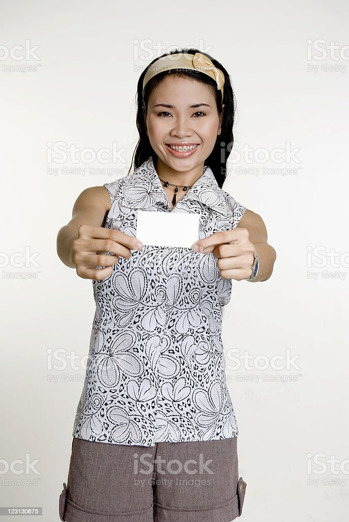 Asian woman with business card royalty-free stock photo