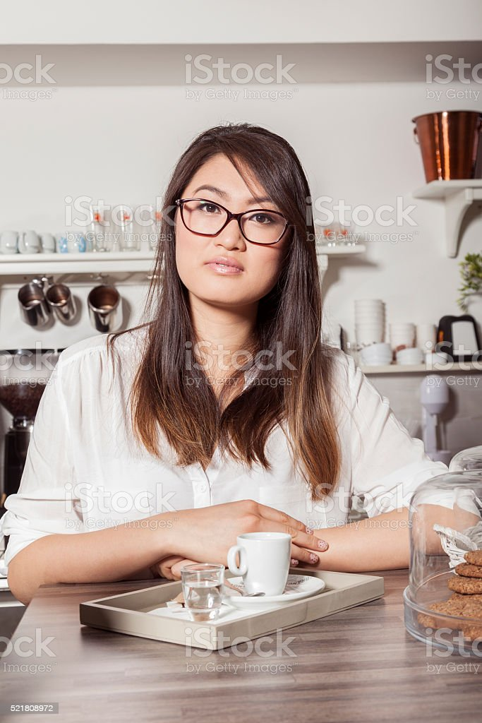 Asian woman with cup of coffee stock photo