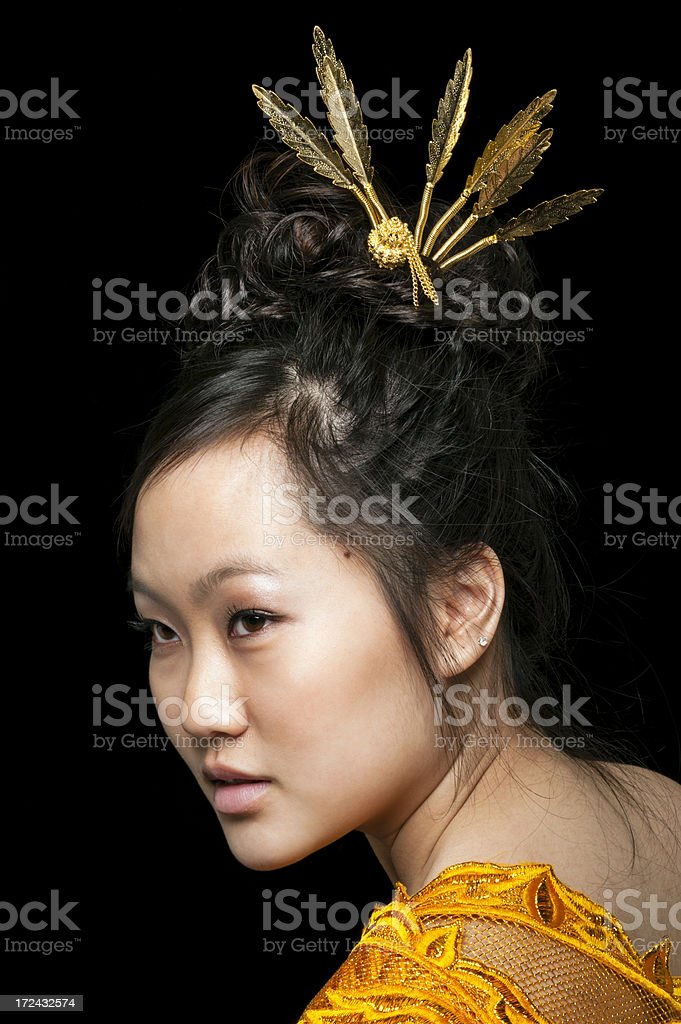 Asian Woman with Gold Jewelry and Scarf royalty-free stock photo