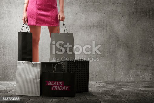 istock Asian woman with many shopping bags 618723366