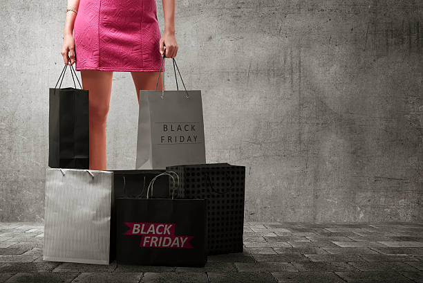 Asian woman with many shopping bags stock photo