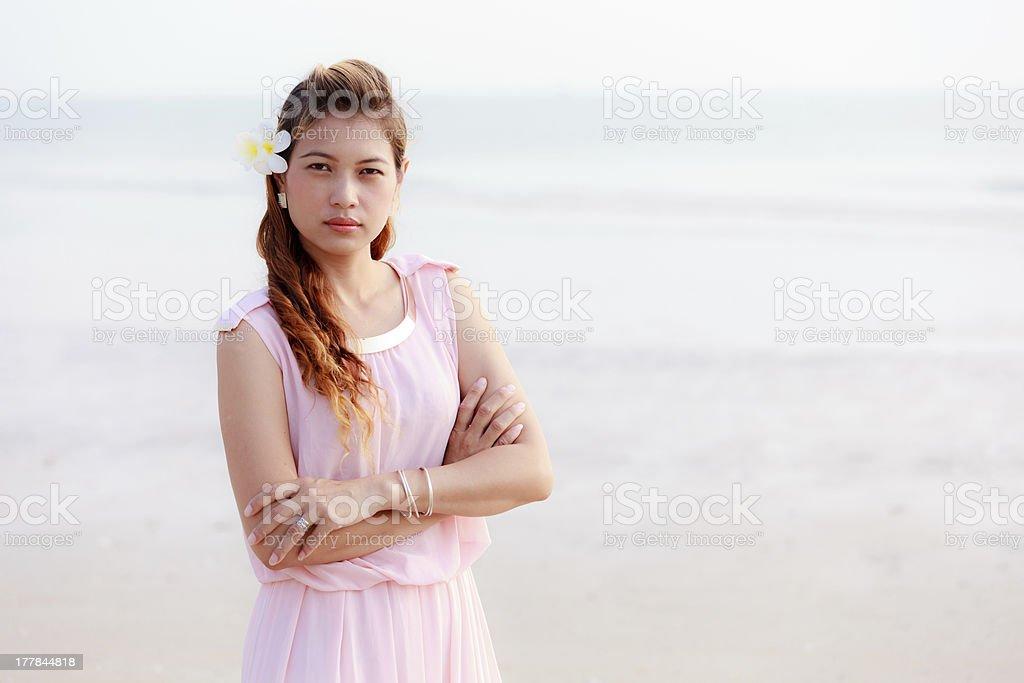 Asian woman with plumeria royalty-free stock photo