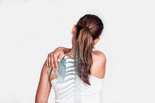 asian woman with shoulder pain - chiropractic care stock photos and pictures
