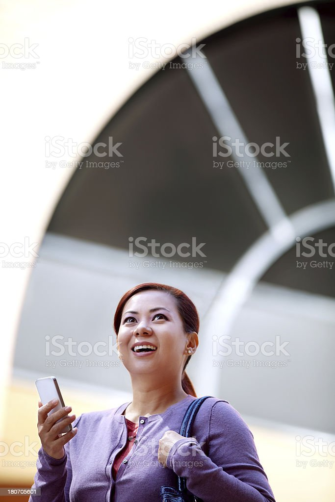 Asian Woman with Smart Phone Outdoor royalty-free stock photo
