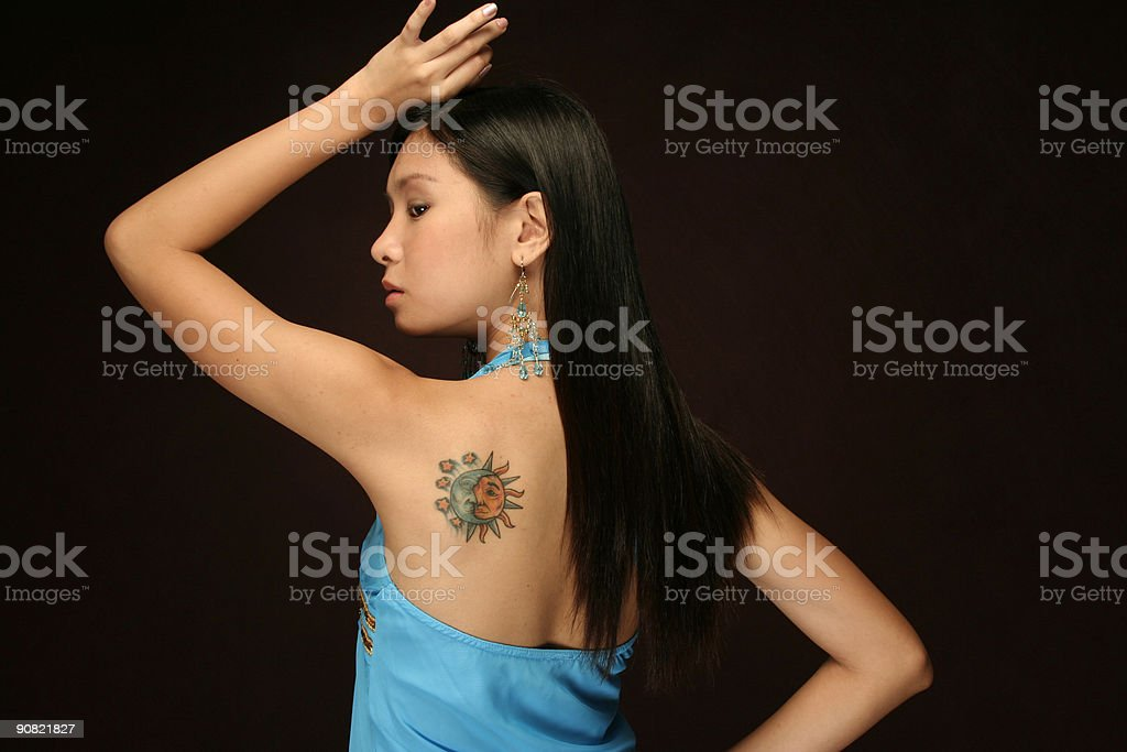 asian woman with sun and moon shoulder tattoo royalty-free stock photo