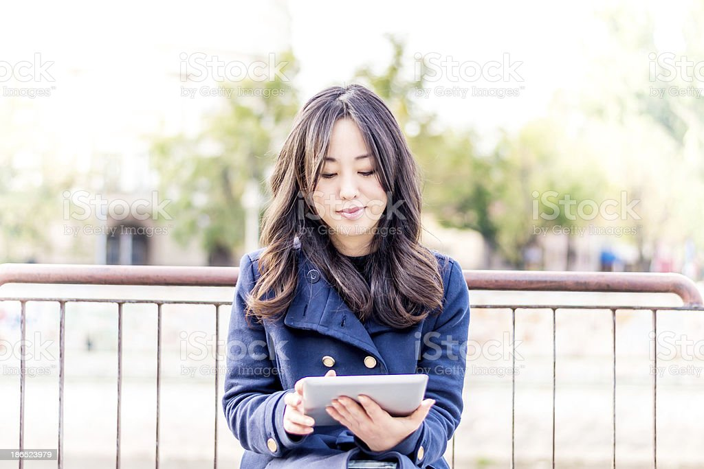 Asian woman with tablet royalty-free stock photo