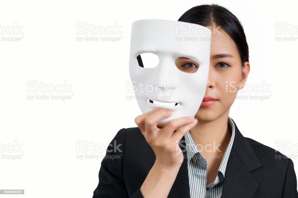 asian woman with white mask and a business suit on white background, concept, spying or ambiguous stock photo