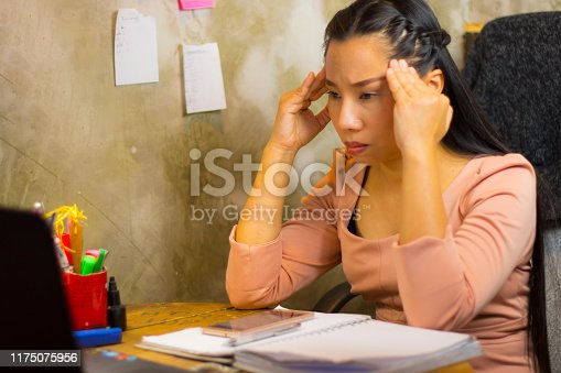 1049512672istockphoto Asian woman worker suffering from hurt,fatigue, pain at neck, muscle, stressed during working with laptop for a long time, 1175075956