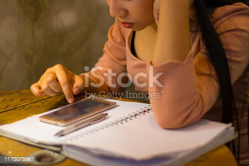 1049512672 istock photo Asian woman worker suffering from hurt,fatigue, pain at neck, muscle, stressed during working with laptop for a long time, 1175075961