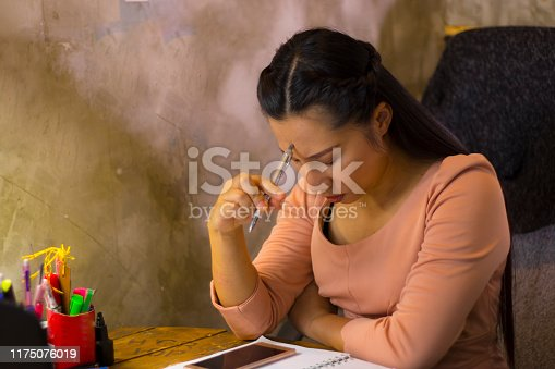 1049512672istockphoto Asian woman worker suffering from hurt,fatigue, pain at neck, muscle, stressed during working with laptop for a long time, 1175076019