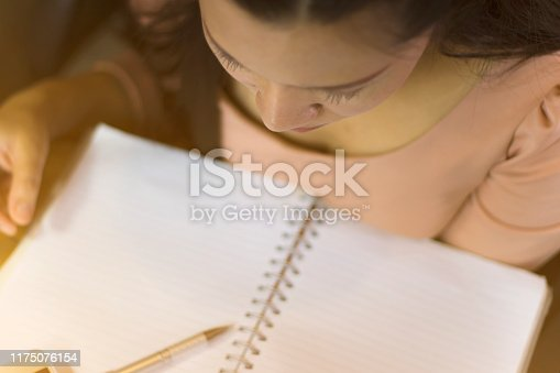 1049512672 istock photo Asian woman worker suffering from hurt,fatigue, pain at neck, muscle, stressed during working with laptop for a long time, 1175076154